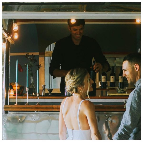 Vintage airstream bar serving beer, wine and cocktails at outdoor wedding